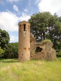 Tower ruins of colonial coffe plantation. Ancient Angerona coffee plantation, now in ruins, in Artemisa province, Cuba, surrounded by a fantastic environment Stock Photos