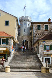 Tower Sahat Kula (Clock Tower) in Herceg Novi, Montenegro. HERCEG NOVI, MONTENEGRO - SEPTEMBER 25, 2015: Unidentified tourists descend on the stairs near the Stock Photo