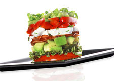 Tower salad. In white background Stock Photography