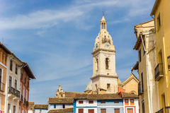 Tower of the Santa Maria church and colorful houses in Xativa Stock Photo