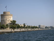Tower by sea. Round tower on side of water in Greece Royalty Free Stock Photography