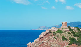 Tower and sea. Sighting tower in Porticciolo, Sardinia Royalty Free Stock Image