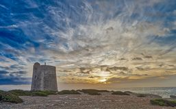 Tower of Ses Portes - Ibiza. Defense tower called Ses Portes, built in the 16th century in Ibiza - salinas beach Royalty Free Stock Images