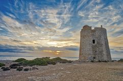 Tower of Ses Portes in Ibiza La canal. Defense tower called Ses Portes, built in the 16th century Royalty Free Stock Images