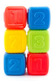 Tower of six colorful building blocks. On white stock photo