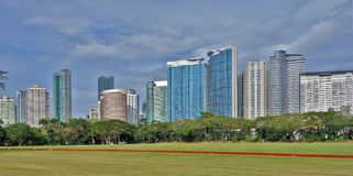 Tower Skyline of Fort Bonifacio in Taguig City. In clear blue skyline with green meadow foreground Royalty Free Stock Photos