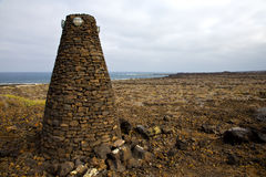 Tower spain  hill      black rocks      lanzarote Royalty Free Stock Photography