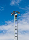 Tower of spot-light  or flood light. Against bright blue sky Royalty Free Stock Photography
