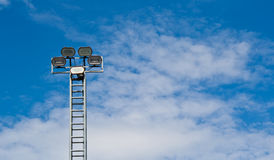 Tower of spot-light  or flood light. Against bright blue sky Stock Photography