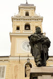 Tower and statue, Parma, Italy. Baroque tower of the Governor's Palace and statue of Garibaldi, Parma, Italy. The encriptions are of the sundial on the facade Royalty Free Stock Image