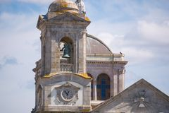 Tower / Steeple of old Portuguese church in Povoa de Varzim, Portugal. Europe. Sacred Heart of Jesus Basilica, built in 1890 royalty free stock photos