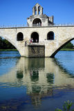 Tower. And stone arch bridge on the river Rhone in Avignon, France Stock Image