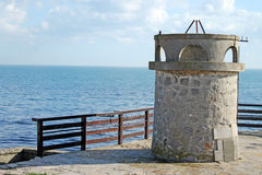 Tower of stone. Stone tower on the background of the sea Royalty Free Stock Images