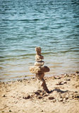 Tower of stone on the lakeside Royalty Free Stock Image