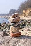 Tower of stones. Built on the beach Royalty Free Stock Images