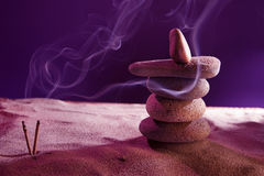Tower of stones and frankincense in the sand Royalty Free Stock Photography