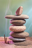 Tower of stones and frankincense in the sand Stock Image