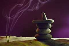 Tower of stones and frankincense in the sand Royalty Free Stock Image