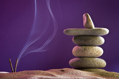 Tower of stones and frankincense in the sand. Seven stones royalty free stock photos
