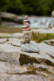 Tower of stones. Tower of pebbles on the river bank Royalty Free Stock Image