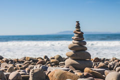 Tower of Stones Pebbles and Rock Near Sea Shore Under the Bright Sky during Daytime Royalty Free Stock Photography