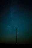 Tower for supervision against  star sky. Royalty Free Stock Photography