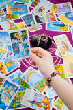 The Tower. Tarot card held in hand. Stock Image