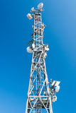 Tower for telecommunications. With clear blue sky in the background Royalty Free Stock Photography
