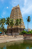 Tower and temple tank of Indian Dravidian Temple Stock Photography