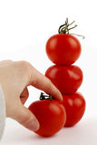 The tower of tomatoes, hand Royalty Free Stock Photo