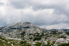 Tower on the top of Sveti Jure mountain and cumulus storm clouds Royalty Free Stock Images