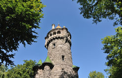 Tower through trees Royalty Free Stock Image