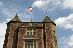 Tower turret. A tower with turrets and a flag with a nice sky Royalty Free Stock Photos