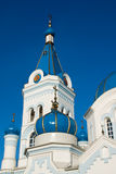 Tower and turrets. Of Orthodox church against blue sky Stock Photo
