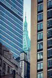 Tower between two buildings. Royalty Free Stock Images