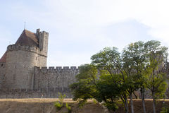 Tower and the wall of Carcassonne city with some trees Royalty Free Stock Photos