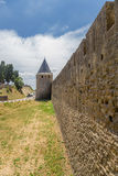 Tower and wall of the fortress of Carcassonne, France. UNESCO List. Fortress of Carcassonne - a medieval architectural complex, located in the French town of Stock Images