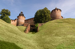 The tower and the wall of the Kremlin. The towers and walls of the Nizhny Novgorod Kremlin on a green hill. Bottom view Stock Photography