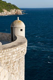 A tower on the wall of old Dubrovnik. A tower on the old wall of Dubrovnik with sea in background Royalty Free Stock Photos