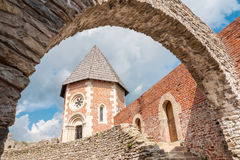 Tower and walls with arch on Medvedgrad castle. Tower and walls with arch on a restored and rebuilt Medvedgrad castle above Zagreb, Croatia on a sunny summer day Royalty Free Stock Images