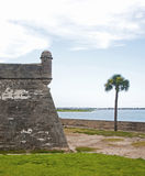Tower, walls and field of the old Castillo de San Marcos, in St. Augustine, Florida. On a sunny and overcast day Stock Photos