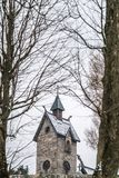 The tower of the Wang Temple in Karpacz. The tower of the medieval Wang Temple in Karpacz, Poland, photographed in winter. It is a Norwegian stave church which Royalty Free Stock Images