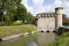 Tower of Water Gate in Cambrai. Cambrai, France. The water gate that allowed the river Escaut to flow through the walls and thus into the town. Built at the end Royalty Free Stock Image