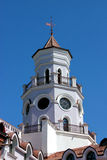 Tower with a weather. Tower with a weather vane and round windows Stock Photos