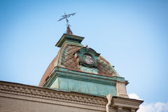 The tower with a weather vane on the roof Stock Photos