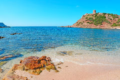 Tower and wet rocks. Wet rocks in Porticciolo shore, Sardinia Royalty Free Stock Photos