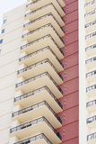 Tower of White Balconies by Red Wall Royalty Free Stock Photos