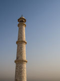 Tower of white marble, Taj Mahal. An isolated tower of white marble, Taj mahal. The biggest white marble building on earth Stock Photography