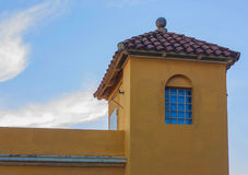 Tower with window covered red tile roof. Royalty Free Stock Photography