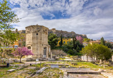 Tower of the Winds, Athens, Greece. Tower of the Winds and Roman forum ruins, Acropolis in background, Athens, Greece Royalty Free Stock Images